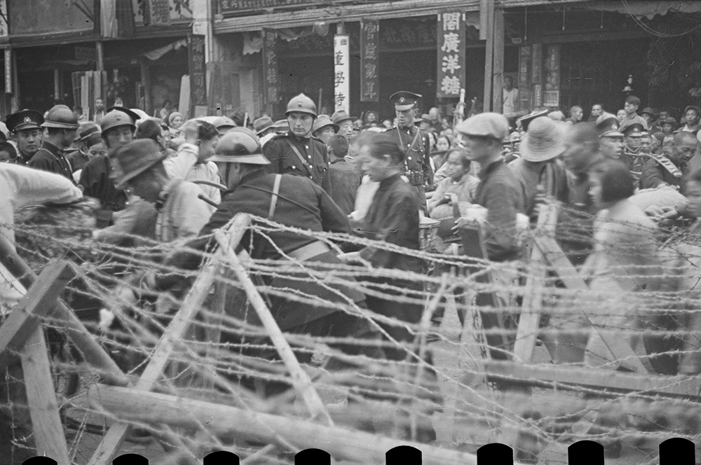 French soldiers at checkpoint barricade, French Concession